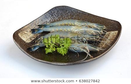 Nyers óriás garnélák piros agyag tányér Stock fotó © dirkr