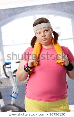 Tired fat woman in sports wear Stock photo © deandrobot