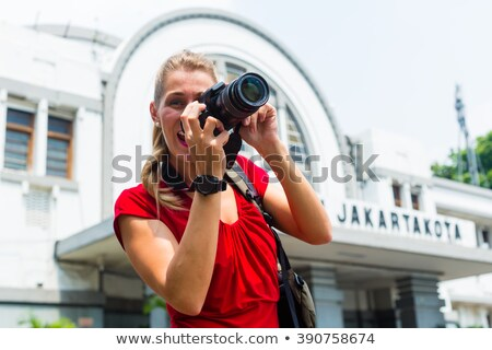tourist taking pictures at jakarta train station stock photo © kzenon