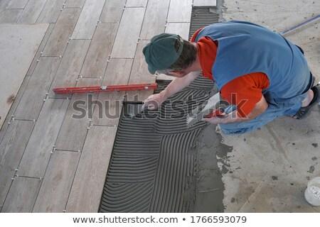 trabalhador · cimento · parede · mão · trabalhar · interior - foto stock © OleksandrO