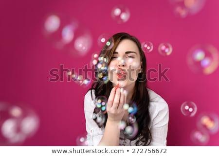 Femme souriante permanent bulles de savon isolé blanche Photo stock © deandrobot