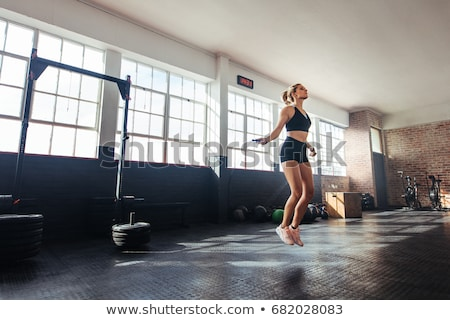 Jump rope in the gym class Stock photo © Novic