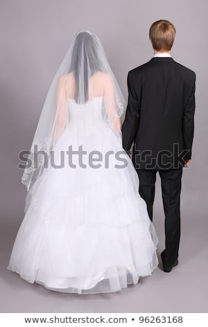 Young brunette beauty or bride, behind a white veil Stock photo © konradbak