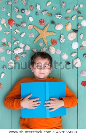 Cute chłopca morza muszle górę Zdjęcia stock © ozgur