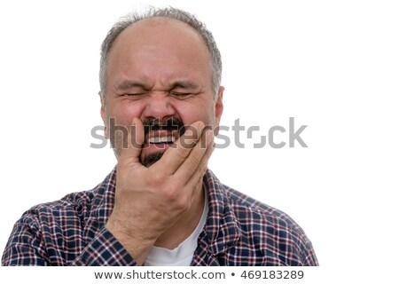 middle aged man woke up with toothache stock photo © ozgur