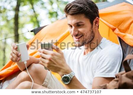 幸せ 男 観光 バッテリー 携帯電話 森林 ストックフォト © deandrobot