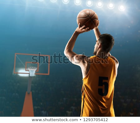 Man shooting basketball in the hoop Stock photo © bluering