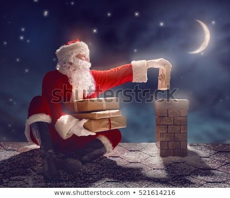 santa claus with gifts sits in chimney on roof stock photo © vectorikart