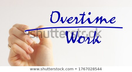 Overtime Handwriting With Blue Marker Stock photo © ivelin