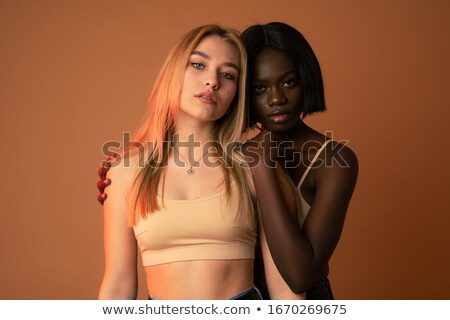 Beautiful charming lady in black bra looking at camera Stock photo © deandrobot