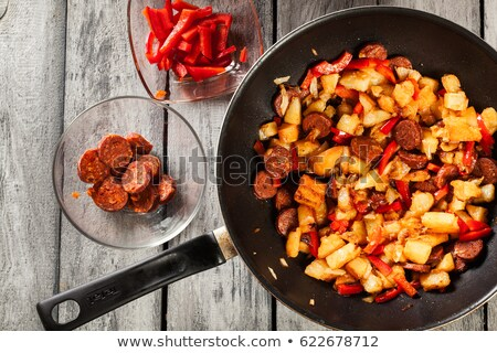 spanish potato and chorizo sausage omelette stock photo © monkey_business