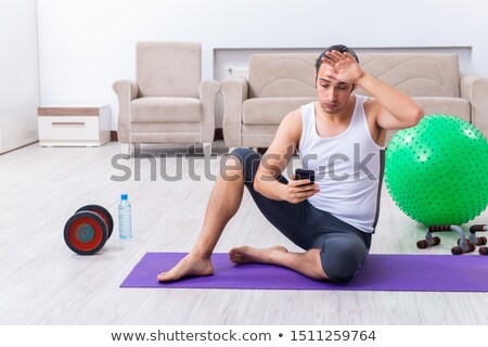Young man exercising with fitball. Stock photo © RAStudio