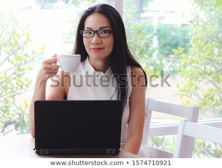 Sorridente senhora cabelos longos óculos sessão Foto stock © deandrobot