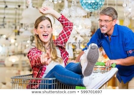 hombre · empujando · mujer · cesta · de · la · compra · hardware · tienda - foto stock © kzenon