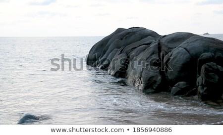 Sunset on the sea above big rocks Stock photo © vapi