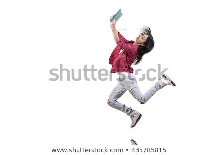 Diplomás egyetemi hallgató ugrik magas egészalakos izgatott Stock fotó © szefei