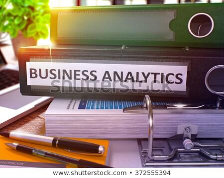 business analytics on black office folder toned image stock photo © tashatuvango