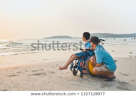 homme · séance · plage · seuls · vide - photo stock © manaemedia