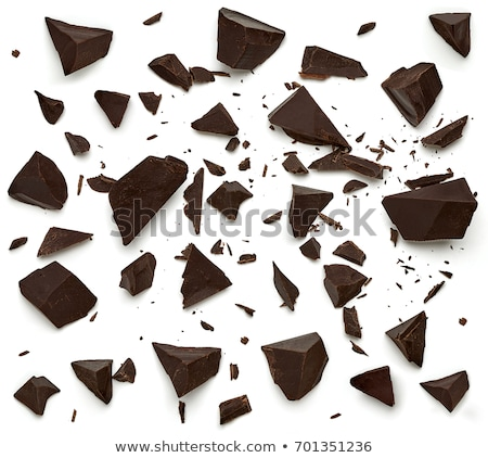 Top view of cracked dark chocolate bar with sweets Stock photo © deandrobot