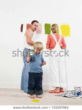 Toddler boy pouring paint onto carpet Stock photo © IS2