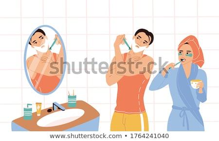 Hombre espejo bano pie manana concentración Foto stock © IS2