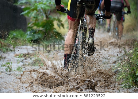 mountain biker on dirt road stock photo © is2
