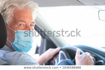 Senior At the Wheel looking in mirror Stock photo © FreeProd
