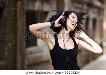 Young woman with mp3 player Stock photo © IS2