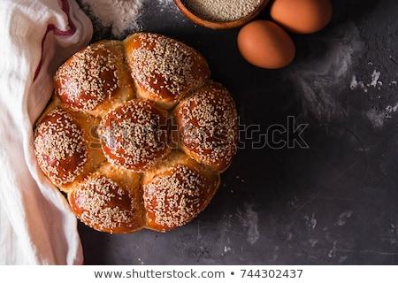 Közelkép ízletes croissant szezámmag kanál étel Stock fotó © bdspn