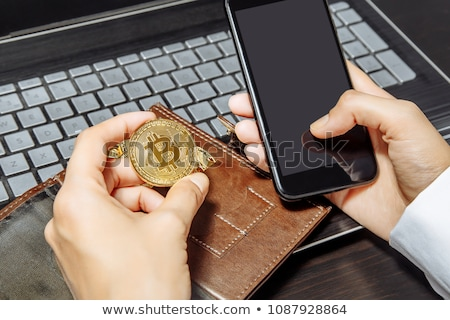 close up of hand with smartphone and bitcoin Stock photo © dolgachov