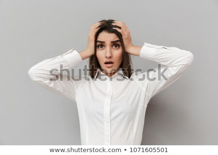 Portrait of frustrated woman in formal dress grabbing her head i Stock photo © deandrobot