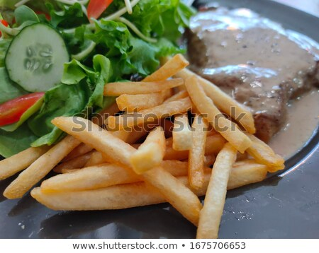 French fries in the disk Stock photo © bluering