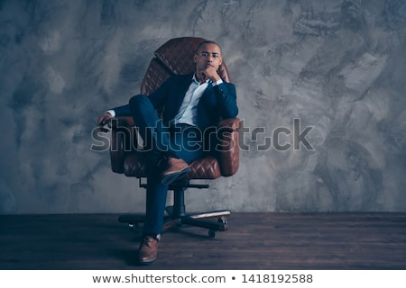 portré · férfi · fekete · csokornyakkendő · ül · szék - stock fotó © feedough