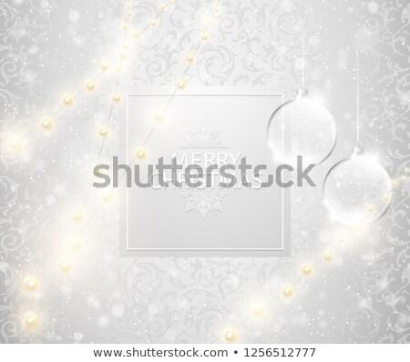 christmas light shining snowfall background merry christmas text on square label transparent glass stock photo © iaroslava
