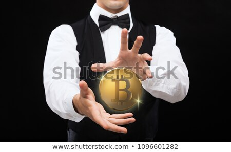 close up of magician with bitcoin over black stock photo © dolgachov