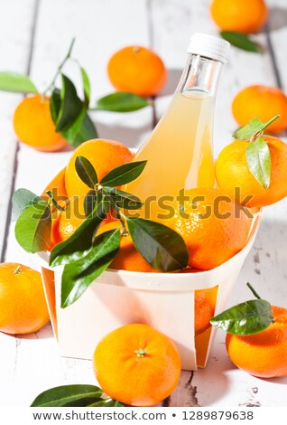 Glass  bottle of fresh mandarin tangerine juice Stock photo © DenisMArt