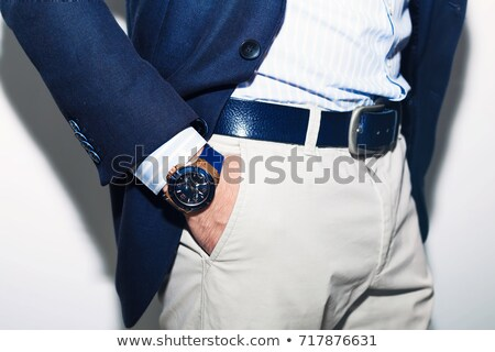 modern man in blue tuxedo standing with hands in pockets Stock photo © feedough