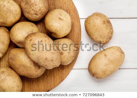 Szakács krumpli fa deszka előkészítés főzés nő Stock fotó © OleksandrO
