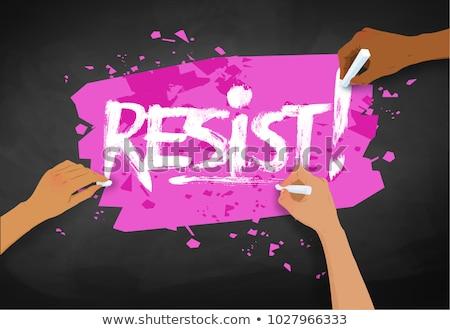 Female hands writing Resist slogan Stock photo © Sonya_illustrations