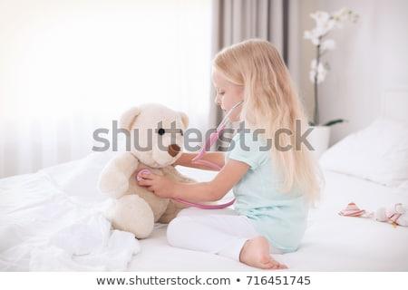 Kicsi szőke lány sztetoszkóp játszik plüssmaci Stock fotó © dashapetrenko