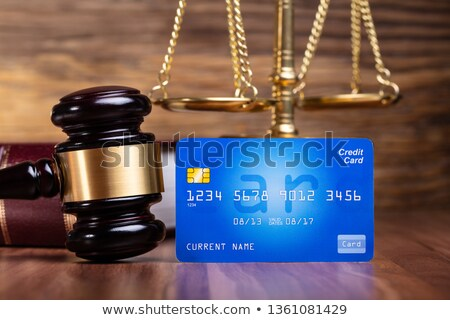 Gavel And Blue Credit Card On Wooden Table Stock photo © AndreyPopov