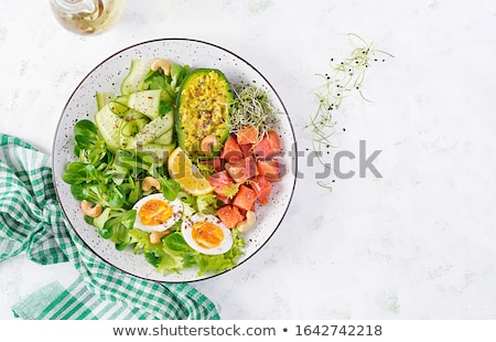 Keto diet, plate with healthy food, avocado, salmon and vegetables Stock photo © MarySan