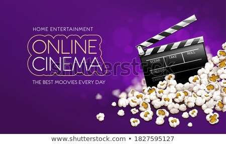 Cinematograpy producer clapperboard in popcorn. Online movie banner Stock photo © LoopAll