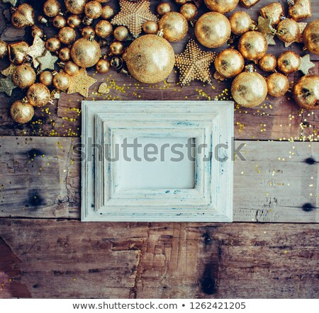 Christmas wooden background with pinecone, letter and golden balls. New year concept. Top view with  Stock photo © AbstractVanilla