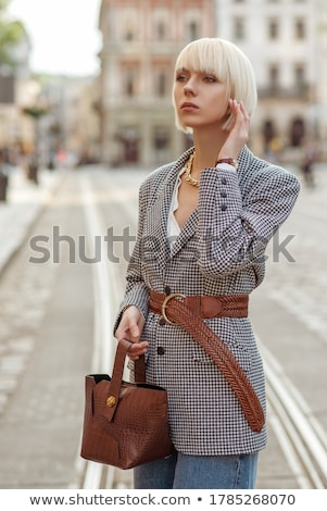 A fashion model outdoor photo of beautiful woman with blond hair in elegant clothes. Stock photo © ElenaBatkova