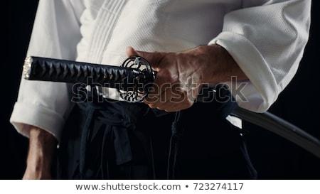 men holding japanese swords stock photo © Bananna