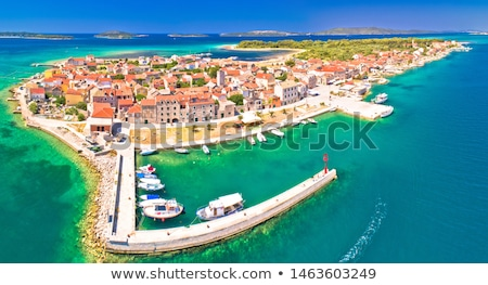 colorful waterfront of krapanj island stock photo © xbrchx