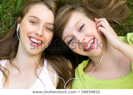 Stock photo: Two Young Girl Outdoors With MP3 Player