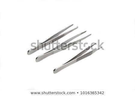 stainless steel precision surgical medical instrument isolated o stock photo © feverpitch