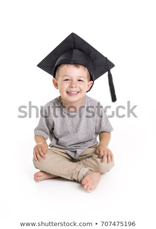 Adorable four years old child boy wearing a mortar board. Stock photo © Lopolo